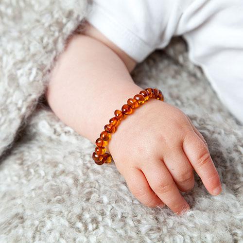 Baby barnsteen armband om